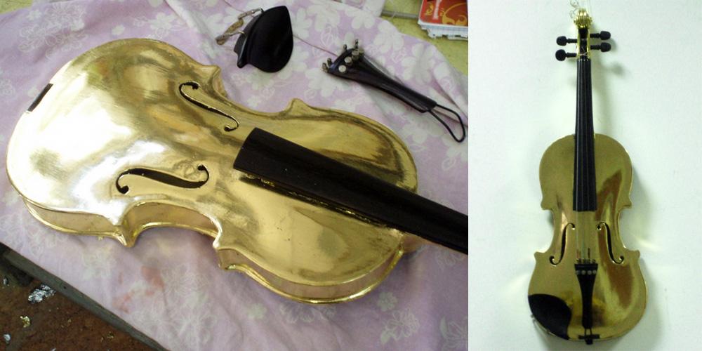 Vergoldung einer Violine